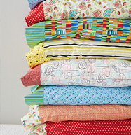 stack of pillows with pillowcases